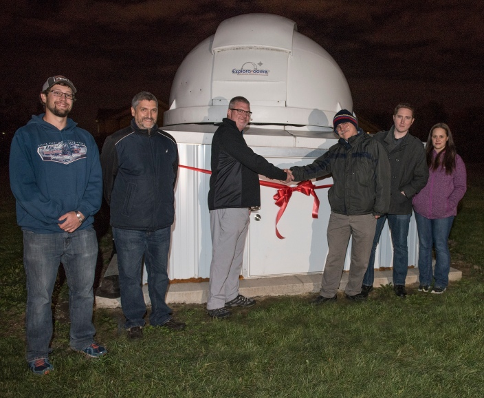 The ribbon-cutting ceremony. From left to right: Joseph Troy, physics major; Mark Masters, chair and professor of physics; Carl Drummond, vice chancellor of academic affairs and professor of geology; Steve Gillam, assistant professor of physics; Matthew Place, physics major, and Amanda Straw, geology major and member of the IPFW Astronomy Club.