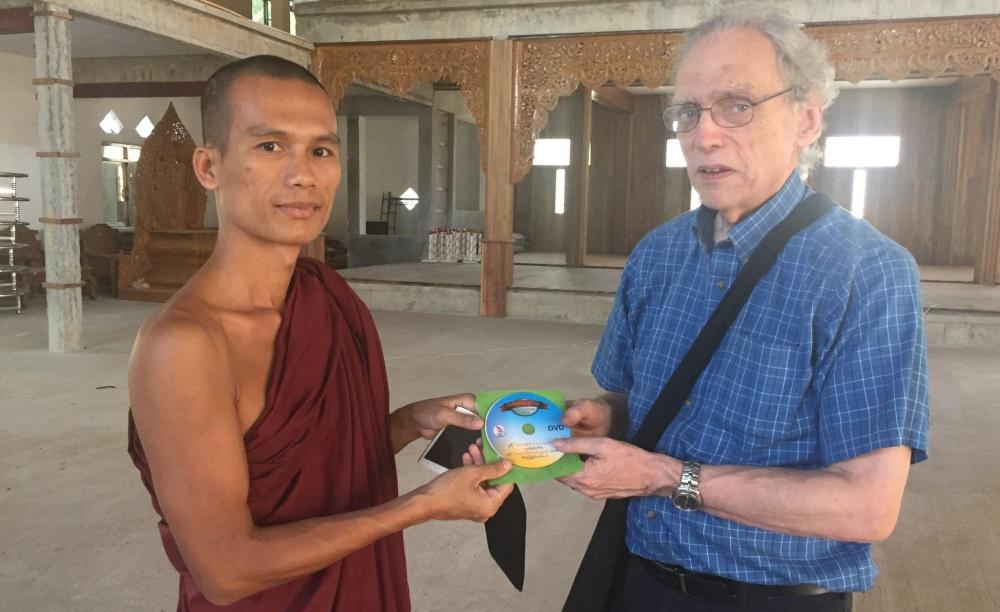 d4-monk-giving-cd-on-mon-language